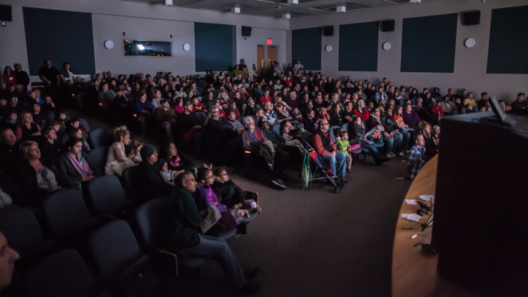 Packed audience watching In Saturn's Rings